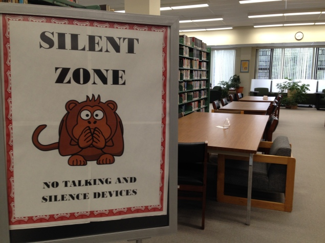 "Sign that reads ""Silent Zone"" in a library."